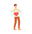young smiling man holding placard with heart vector image vector image