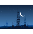Oil and gas rigs over night desert vector image