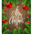 merry christmas lettering in fir branches frame vector image vector image