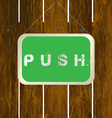 Push sign hanging on a wooden fence vector image vector image