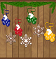 christmas cookie garland on a wooden background vector image vector image