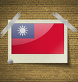 Flags Taiwanat frame on a brick background vector image