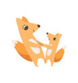 loving mother fox and her little baby holding vector image vector image