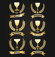 golden winner cups with ribbon vector image vector image