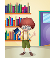 A smiling boy holding a book in front of the vector image vector image