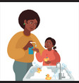 mother washes girls hands with liquid soap vector image