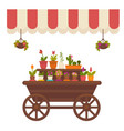 wagon with flowers in store vector image vector image