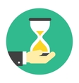Hourglass on hand icon vector image vector image