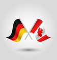 two crossed german and canadian flags vector image vector image