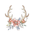 antlers with a wreath of flowers hand drawn vector image vector image