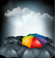 A rainbow umbrella amongst grey ones Uniqueness vector image