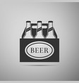 pack of beer bottles icon on grey background vector image vector image