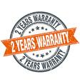 2 years warranty round orange grungy vintage vector image vector image