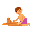 little boy making sand castle isolated on white vector image vector image