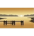At sunrise in sea with pier silhouette vector image