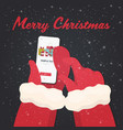 santa hands using mobile app gift present boxes on vector image