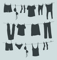 Silhouettes laundry on a rope