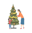 mother and son decorating christmas tree happy vector image vector image