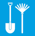 rake and shovel icon white vector image vector image