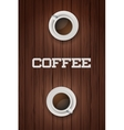 Two cups of coffee on wooden table vector image vector image