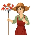 Woman with garden hat holding rake vector image