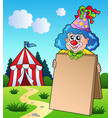 clown holding board near tent vector image
