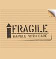 grunge fragile box sign with arrow up on cardboard vector image