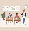 girl and boy pupils sitting on desks at classroom vector image
