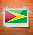 Flags Guyana scotch taped to a red brick wall vector image