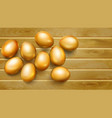 golden easter eggs on wooden planks vector image vector image