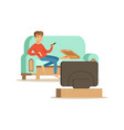 young man character sitting on a sofa and watching vector image vector image