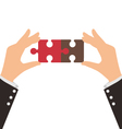 Two Business Hands connect two pieces of puzzle vector image vector image