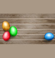 colored easter eggs on wooden planks vector image vector image