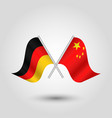 two crossed german and chinese flags vector image vector image