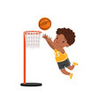 african american boy throwing ball into basket vector image vector image
