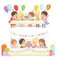 cute boys and girls sitting at festive table with vector image vector image