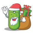 santa with gift price tag mascot cartoon vector image