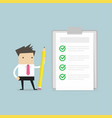 businessman holding a pencil and checklist vector image