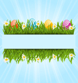 Easter colorful eggs and camomiles in green grass vector image