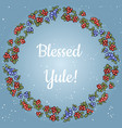 blessed yule lettering in a wreath of red and blue vector image vector image