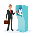 businessman stands next to terminal for cash vector image vector image