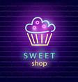 sweet shop neon logo sign on dark brick wall vector image
