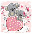 two koalas is sitting on a heart vector image vector image