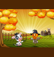 cartoon cow with halloween scarecrow in the farm b vector image vector image