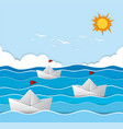 origami boats sailing in the sea vector image vector image