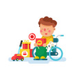 boy in a wheel chair with toys vector image vector image