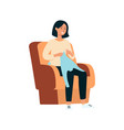 a young brunette woman sits on an armchair smiles vector image vector image