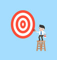 businessman on ladder painting big target goal by vector image