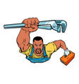 african repairman with an adjustable wrench vector image