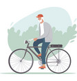 elderly man riding a bicycle in park vector image vector image